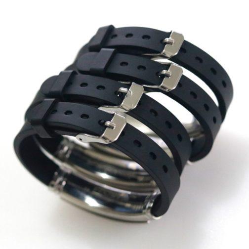 Bracelets noirs en silicone LGBT arc-en-ciel - focus systèmes fermoirs boucle ardillon